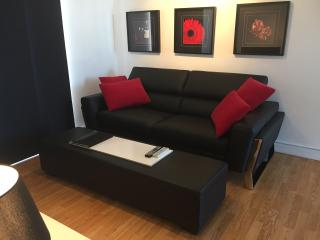 Double thickness, 3 seater black Italian leather lounge