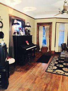 Living room with Victorian Steinway piano