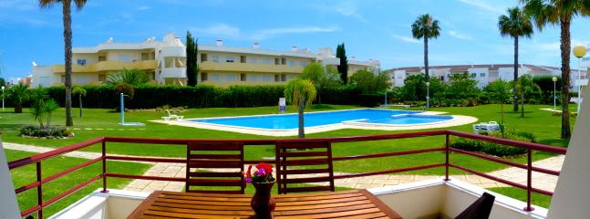 Panoramic balcony view of the garden and swimming pools ..