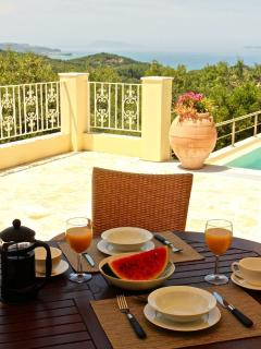 Breakfast on the patio overlooking the mountains and sea