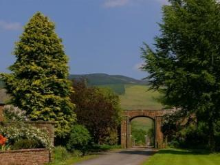 The arched entrance to Melmerby with the the Pennines behind