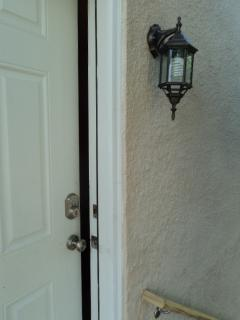 Electronic deadbolt to 2nd floor's private entrance off deck