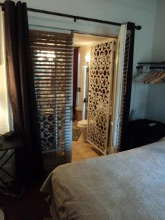 Spa bedroom on 1st floor with 3 sets of French doors including to full bath/kitchenette & tub for 2