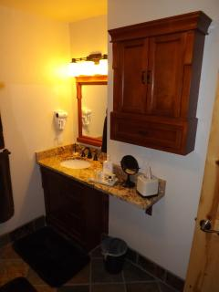 Everything new and updated. Plenty of bathroom storage.