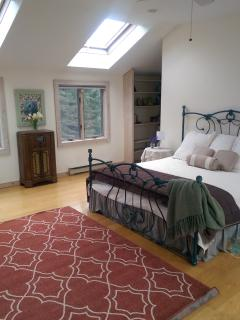 Private master bedroom with king bed is bright and sunny