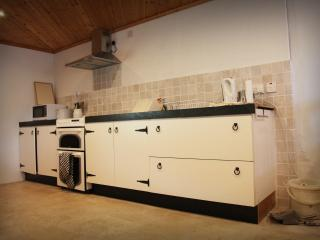Kitchen with ample storage, double oven, hob and extractor, sink and double drainer