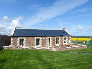GREY CROFT, all ground floor, woodburner, parking, front patio, in Embleton