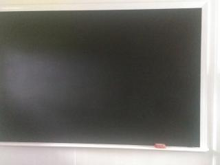 Big chalkboard- great for playing pictionary, which is in the bookshelf for you!