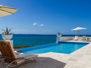 With an infinity pool overlooking the sea and St. Martin, this villa, on a private small beach, also has great snorkeling. IDP VIS, Anguila