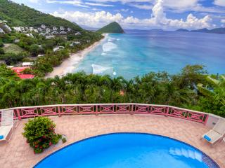 Nestled in lush hills above Long Bay, this villa has spectacular ocean views. KLG SUN, Tortola