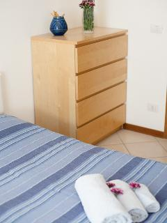 Bedroom nr. 2: french size bed, drawers and air conditioning