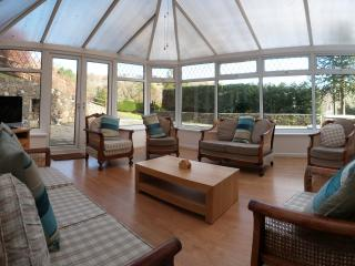 Spacious conservatory to relax and enjoy the amazing views