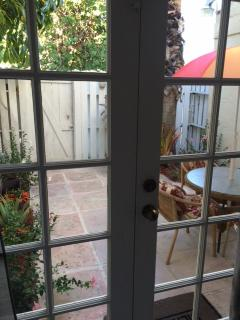 Looking out into your private Courtyard/Garden from inside the unit