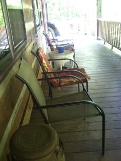 Front porch seating overlooks the creek