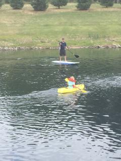 Fun pond toys!  Stand up paddle board and kid kayak