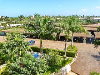 Peaceful beachfront condo w/ heated pool & balcony w/ a sunrise view