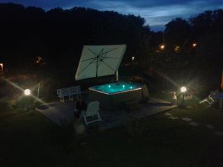 The jacuzzi and the sun deck by night
