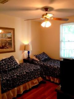twin beds in second bedroom can be pulled together for a king bed, full closet dressers and TV