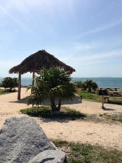 one of the many tiki huts available on the open ocean right there at Fort Zackary Taylor