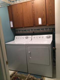 Laundry room with iron and ironing board