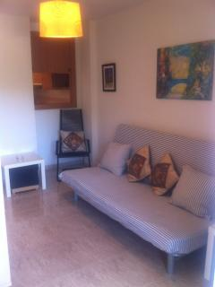 salon con sofa cama 1,35