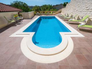 Villa Kogo Apartman 1 with a swimming pool,
