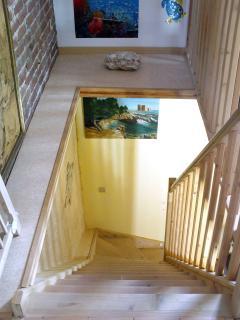 accès à la chambre, à l'étage pour 3 personnes