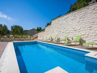 Villa Kogo Apartment 6 with a swimming pool