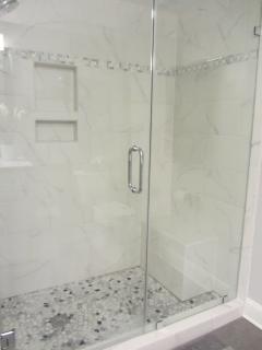 All new ceramic tile walk-in shower in Master Bathroom.