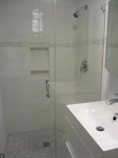 Newly remodeled ceramic tiled shower and new vanity in Queen Bathroom.