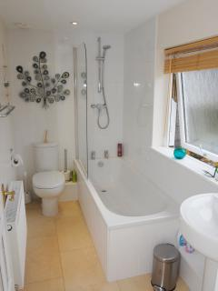 Bright and well equipped bathroom with constant hot water.