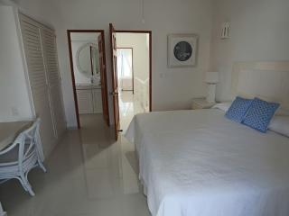 One of the spacious breezy King bedrooms with buil it robes and vanity