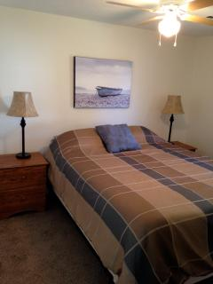 End bedroom with queen size bed.