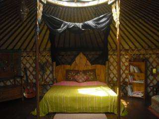Interior veiw of Eastern yurt with hand made queen size bed, A good size yurt for larger families.
