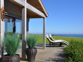 House 40 - Finished to a high specification with a true beach house feel, this h