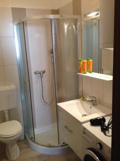 New bathroom with complementary toiletries and a washing machine