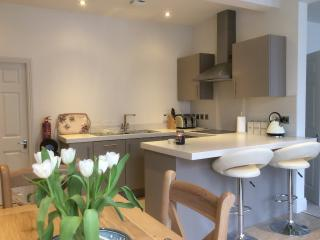 Stunning designer kitchen, with separate utility room, breakfast bar and dining four four.