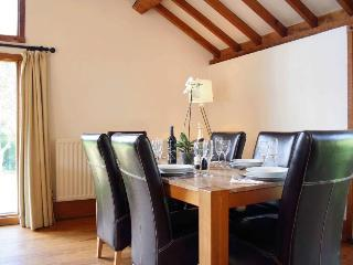 Damson Cottage dining area.  This table now has 4 x leather chairs.