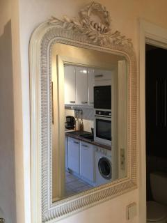 Stylish mirror with glance at kitchen