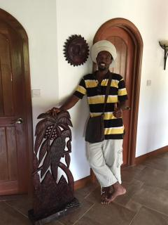 Local artist 'Stone' with his latest creation for Villa Papillon. Find him at La bas Beach*