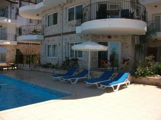 The Apartment, poolside and first floor balcony over looking the pool.