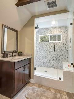 Master Bath | Walk in shower with bench seating. Ample towels & toiletries