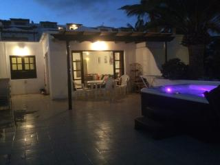 terrace at night with hot tub and lighting