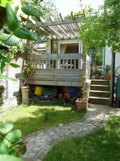 From the decking you descend to the quaint garden with small pond & jasmine covered arbour.