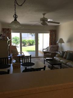 Family Room with queen size sleeper leather sofa, recliner, rocker, eat in dining area too!