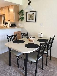 Dining table with seats for (4) plus 2 additional barstools at the eat in kitchen counter!