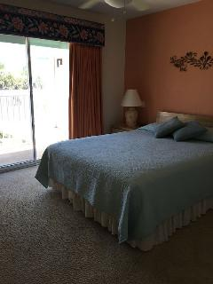 Master bedroom, comfy queen size bed with ocean view from the glass doors! Chairs for balcony too!
