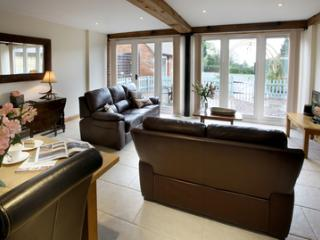 Modern spacious lounge with TV/DVD, free wi-fi and underfloor heating throughout.