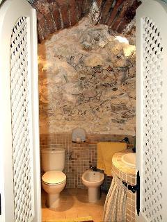 Unique 'cave' bathroom.