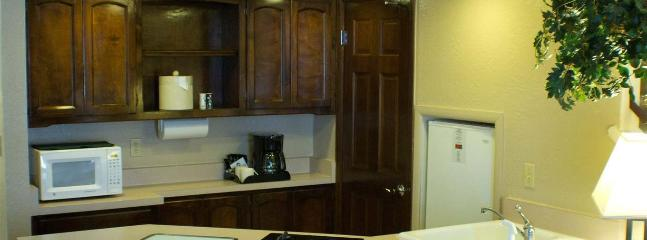 Kitchen with stove top, refrigerator, microwave, toaster oven, coffee maker, D/W and W/D in unit.